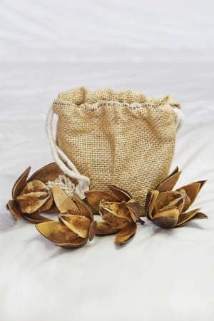 hessian bag: Vertical take of an arrangement of Cotton Squares and Hessian Bag oven a quilted sheet  Shot location of this generic capture, Bangalore studio, India