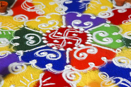 divali: Multi colored patterned rangoli design a ritual performed by hindus generally during the hindu new year and divali along with the light of diwas