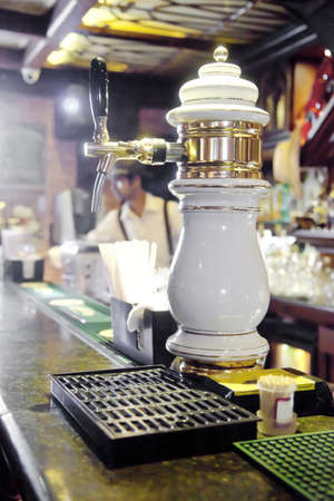 beer pump: Vertical take of a beer pump, nozzle back to front to allow customers to self serve  Generic shot location India Stock Photo