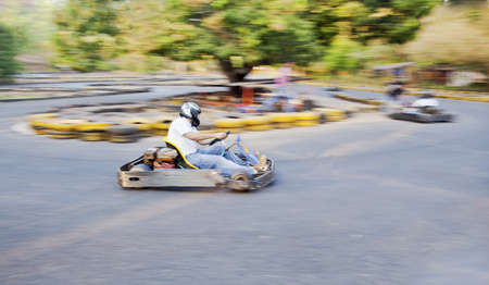 buffers: Horizontal generic grab at a public go kart track in Goa during a race, positon of shot from the safety barriers at a U bend