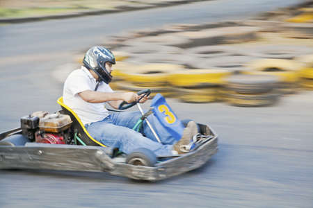 buffers: Horizontal generic grab at a public go kart track in Goa during a race as driver number 3 zooms past