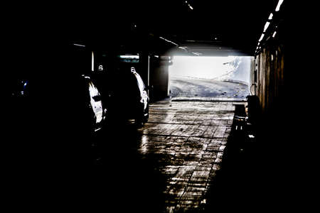 photgraphy: Generic photograph of daylight coming between the dark shadows of an under ground vehicle parking facility in Bombay, India