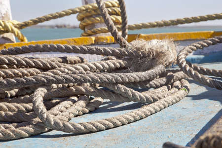 coiled rope: Horizontal abstract image of coiled mooring rope shapes on a ferry at Bet Dwarka, Gujarat, India