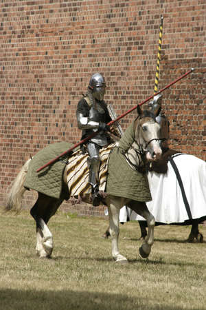 Knight on horse with weapon in hand