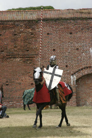 Knight on horse with weapon in hand  photo