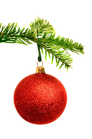Christmas ball and fir branch over white background