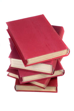 Stack of old books on gray background.