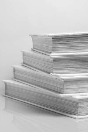 Stack of books on white background photo