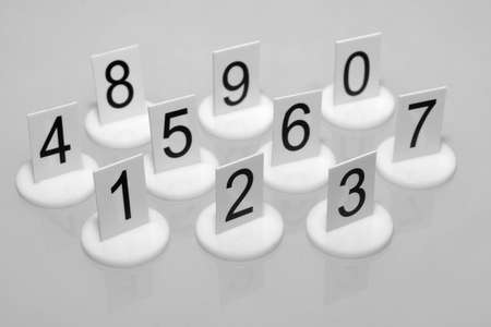 Numbers on supports on gray background  Stock Photo