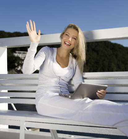 young woman with a laptop on the pier Stock Photo - 14938254