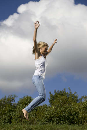 Young girl jumping in air photo
