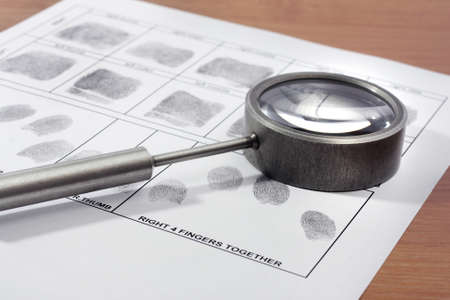 Magifying glass inspecting a fingerprint
