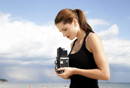 photographer girl on the beach Stock Photo - 15845198