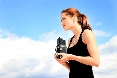 photographer girl on background of the sky Stock Photo - 16378055