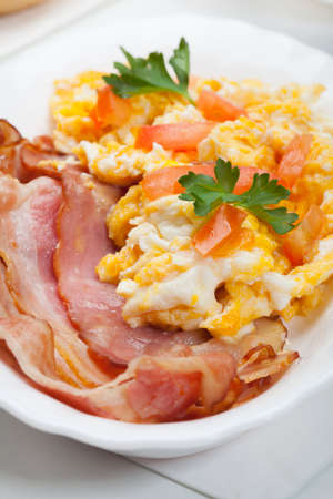 scrambled: scrambled eggs with slices of bacon