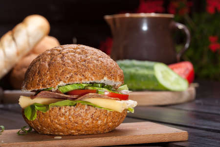 Healthy sandwich with cucumber, lettuce and tomato photo