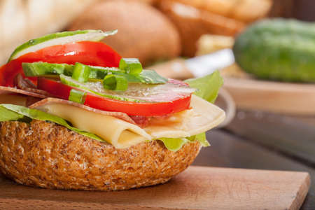 Healthy sandwich with cucumber, lettuce and tomato. photo