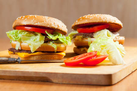 Delicious hamburgers on a wooden table photo