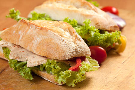 Tasty sandwiches with vegetables on a wooden table. Stock Photo