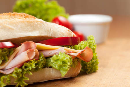 Tasty sandwiches with vegetables on a wooden table