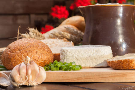 Country breakfast consisting of bread, cheese, milk and garlic. photo