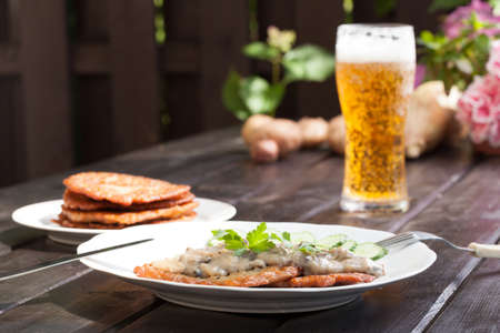 Potato pancakes with mushroom sauce and beer