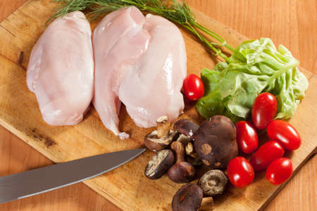 Raw chicken breast with the other components of the food. Stock Photo