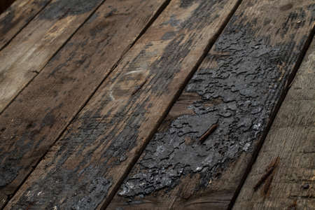 farm structure: Dry rotting wood timbers with rusted nails in sunrise lighting on an old farm structure. Stock Photo