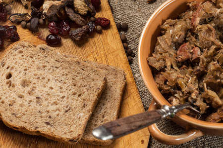 Traditional polish sauerkraut (bigos) with mushrooms and cranberries.