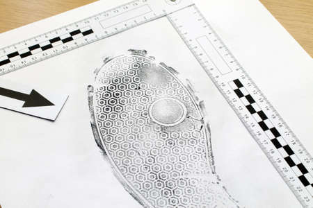 incriminate: Footprint shoe protector disclosed during the examination. Stock Photo