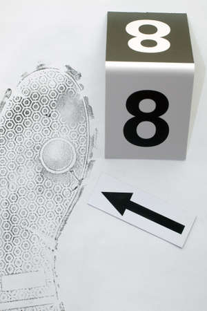 Footprint shoe protector disclosed during the examination. Stock Photo