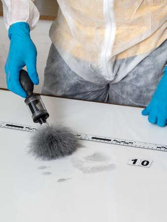 incriminate: Disclosure of forensic evidence using fingerprint powders. Stock Photo
