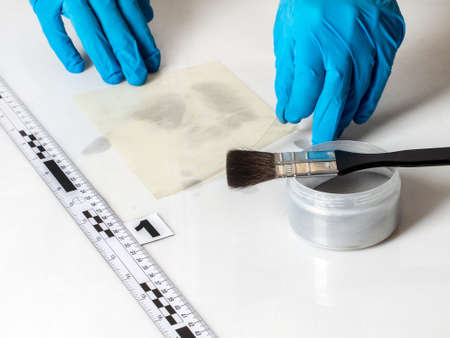 circumstantial: Disclosure of forensic evidence using fingerprint powders. Stock Photo