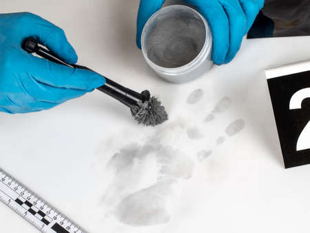 heist: Disclosure of forensic evidence using fingerprint powders. Stock Photo