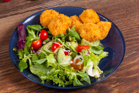 Mixed salad with chicken pieces. Stock Photo