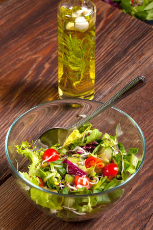 Salad with tomato, cucumber, garlic and olive oil. Stock Photo
