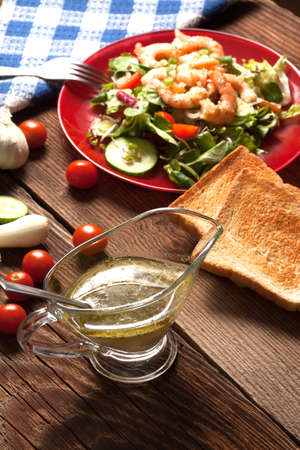 Salad with tomato, shrimps and toasted bread  photo