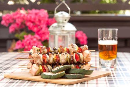 Grilling shashlik on wooden table.