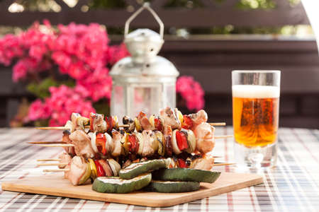 Grilling shashlik on wooden table. Imagens - 31119309