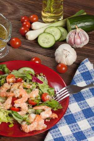 Salad with tomato, shrimps and toasted bread. photo
