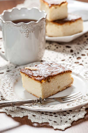 Slice of cheesecake on a stylish plate. Selective focus. Stock Photo