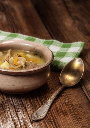 Soup of porridge on a wooden table