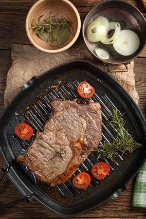 Fried beef steak in a frying pan. photo