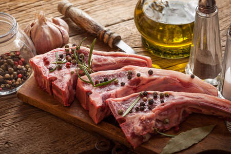 Raw lamb chop ready for frying. Selective focus. Stock Photo