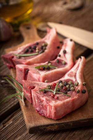 the lamb: Raw lamb chop ready for frying. Selective focus. Stock Photo