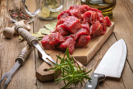 Beef stew prepared on a chopping board.