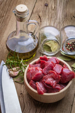 Raw beef diced in a wooden bowl. Stock Photo