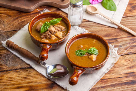 goulash: Traditional goulash soup with pork and dumplings. Stock Photo