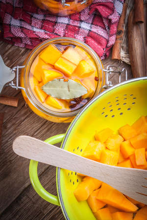 pickle: Pumpkin pickle in a glass container on a wooden table. Stock Photo