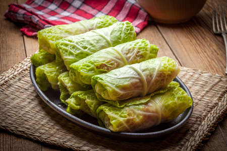 leaves: Cabbage rolls stuffed with meat and grits prepared for cooking. Stock Photo